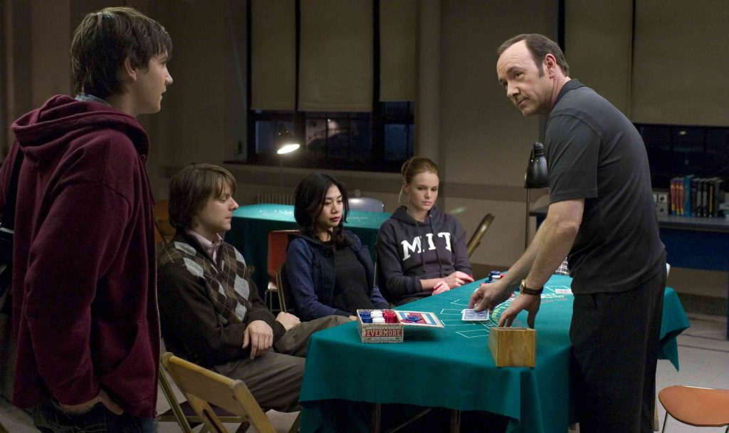 """In Columbia PicturesÕ 21, the M.I.T. blackjack team Ð a group of students that has figured out how to take Vegas for millions Ð practices counting cards.  Left to right: Ben Campbell (Jim Sturgess), Fisher (Jacob Pitts), Kianna (Liza Lapira), Jill Taylor (Kate Bosworth), Micky Rosa (Kevin Spacey).  Directed by Robert Luketic, the screenplay is by Peter Steinfeld and Allan Loeb, based upon the book """"Bringing Down the House"""" by Ben Mezrich.  The producers are Dana Brunetti, Kevin Spacey, and Michael De Luca.  The film opens in theaters nationwide on March 28, 2008."""